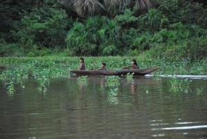 Indian kids in a canoe
